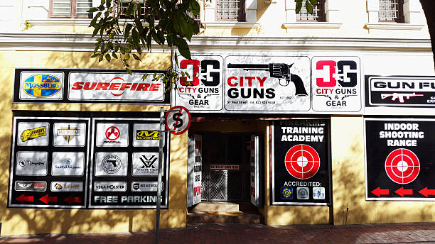 Gun shop in 18th century centre of Cape Town Cape Town, South Africa - May 19, 2016:  A gun shop in the quaint old centre of Cape Town. South African gun control regulations require that prospective firearm owners acquire proficiency certificates: this shop offers a range of services, including training accredited by the police and an indoor shooting range. gun shop stock pictures, royalty-free photos & images