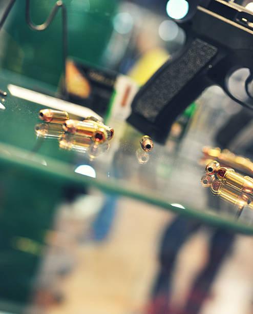 Gun Store bullets and gun on counter in retail gun store gun shop stock pictures, royalty-free photos & images
