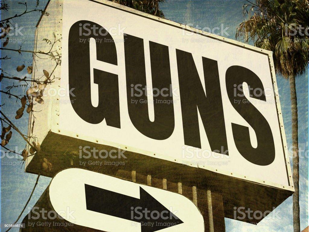 gun store sign stock photo