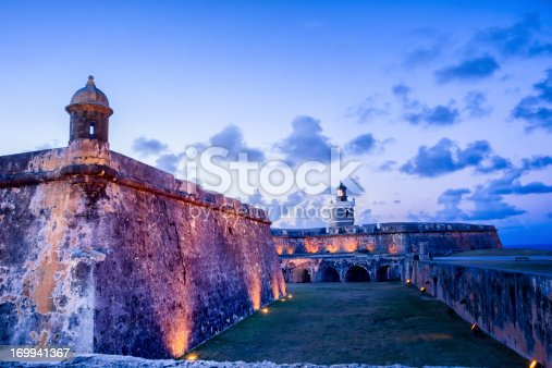 Tower and lighthouse at El Morro fort in San Juan, Puerto Rico lit up at night