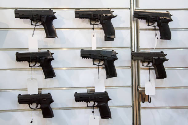 Gun wall rack with pistol. Gun wall rack with pistol. gun shop stock pictures, royalty-free photos & images