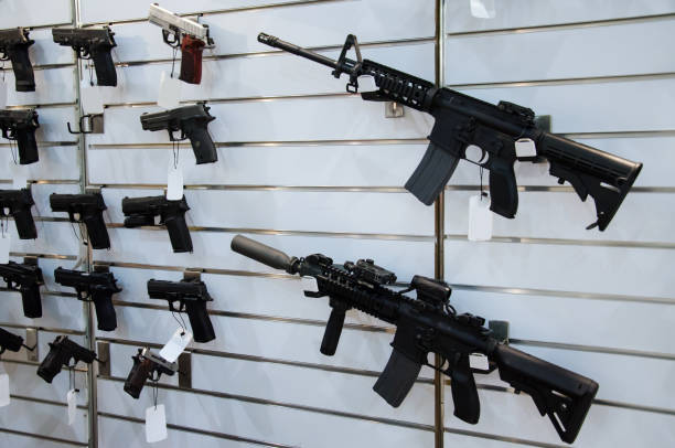 Gun wall rack with rifles and pistol. Gun wall rack with rifles and pistol. gun shop stock pictures, royalty-free photos & images