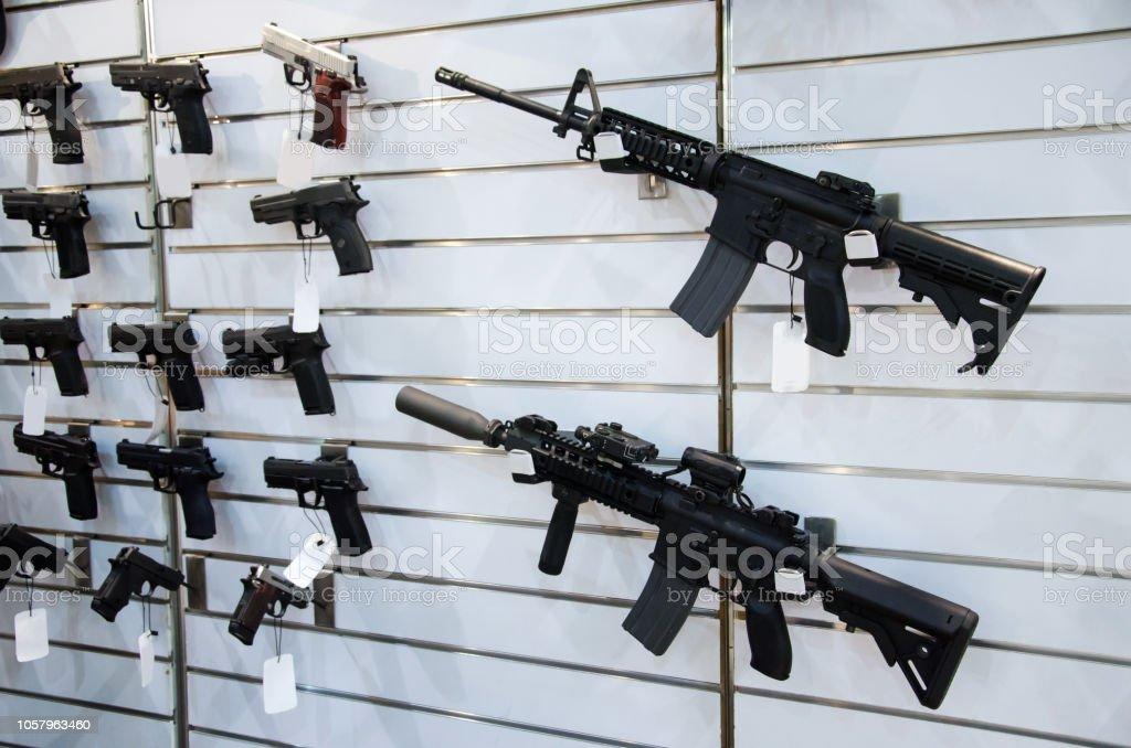Gun wall rack with rifles and pistol. Gun wall rack with rifles and pistol. AR-15 Stock Photo
