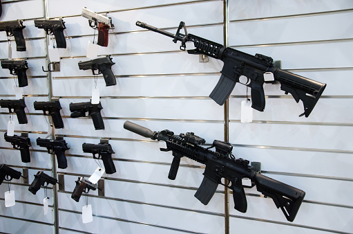Gun Wall Rack With Rifles And Pistol Stock Photo - Download Image Now