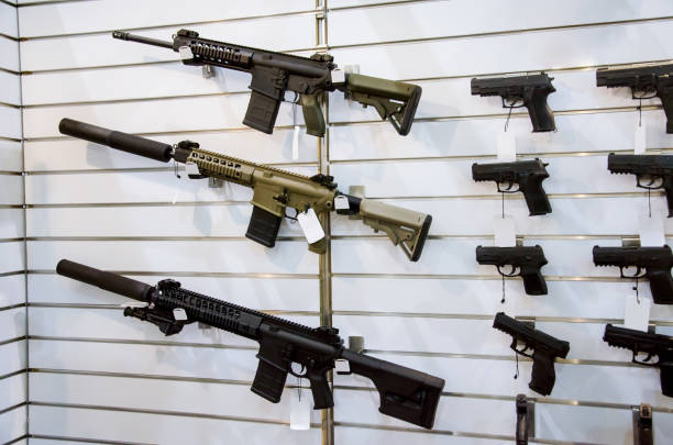 Gun wall rack with rifles and pistol. stock photo