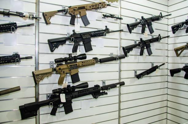 Gun wall rack with rifles stock photo