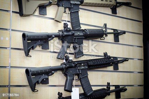 istock Gun wall rack with rifles 917183784