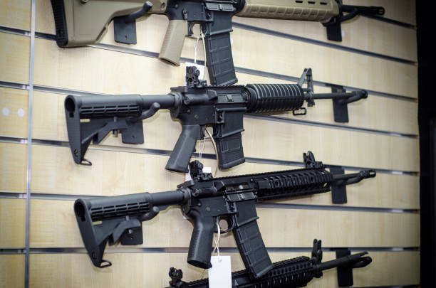 Gun wall rack with rifles stock photo