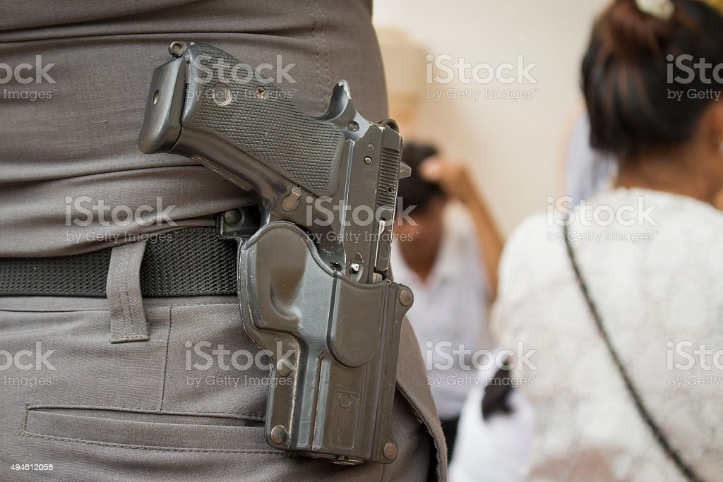 gun with a police to protecting the people stock photo