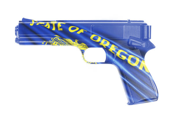 Gun wrapped in the Oregon state flag A stock photo of a Gun wrapped in the Oregon state flag oregon us state stock pictures, royalty-free photos & images