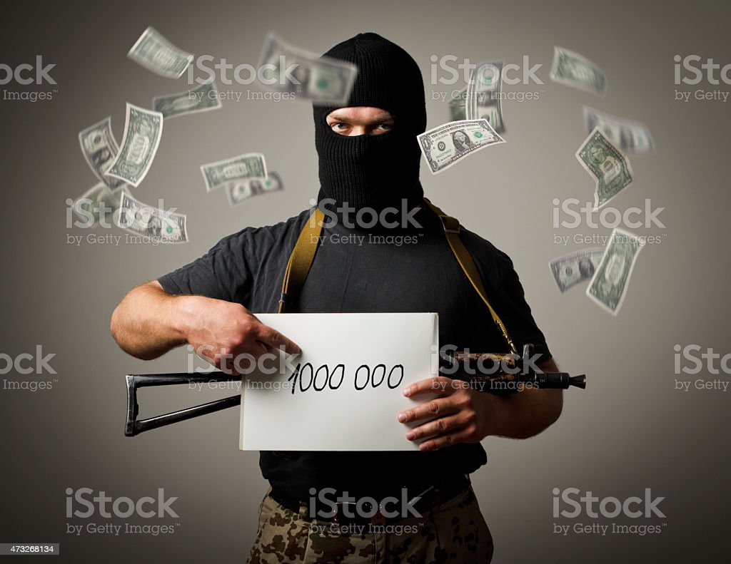 Gunman and one million dollars. stock photo