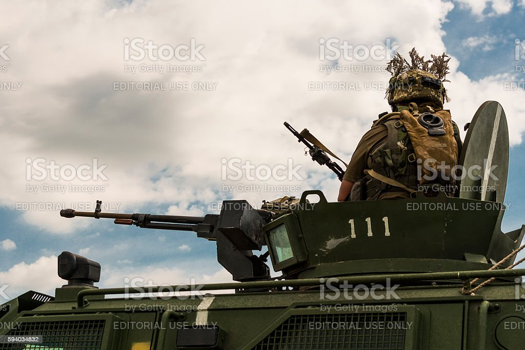 Gunner prepares to shoot a machine gun NSVT 12.7 stock photo