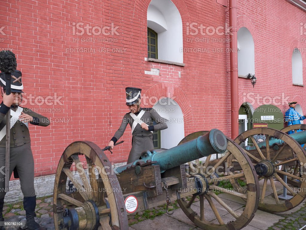 Gunners near ancient cannons. Peter and Paul Fortress, St.Petersburg, Russia stock photo