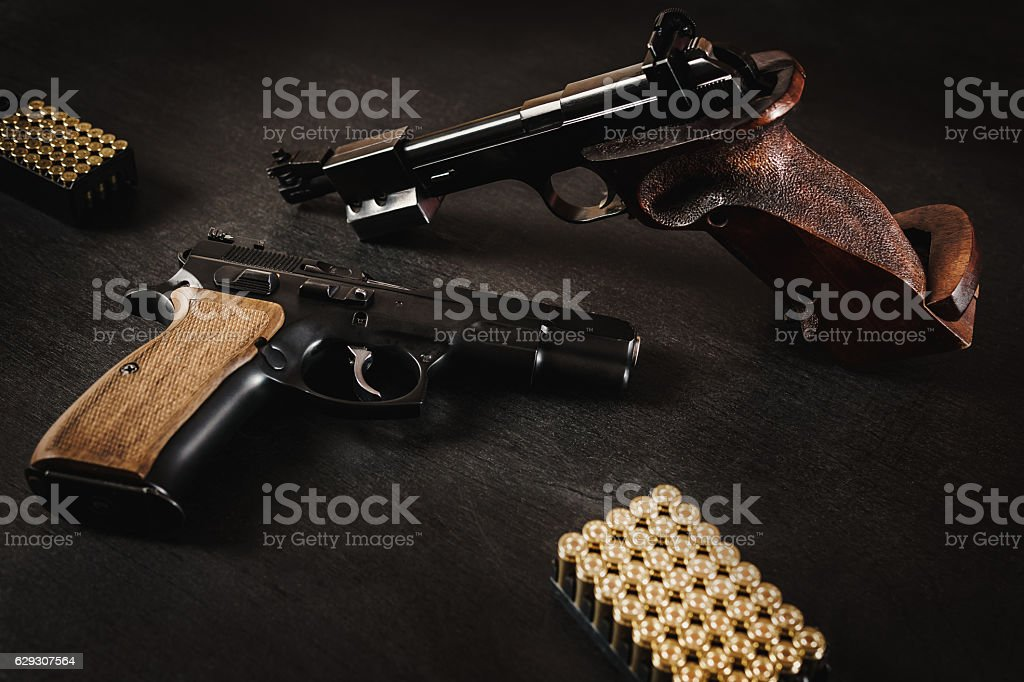 guns and bullets on the table stock photo