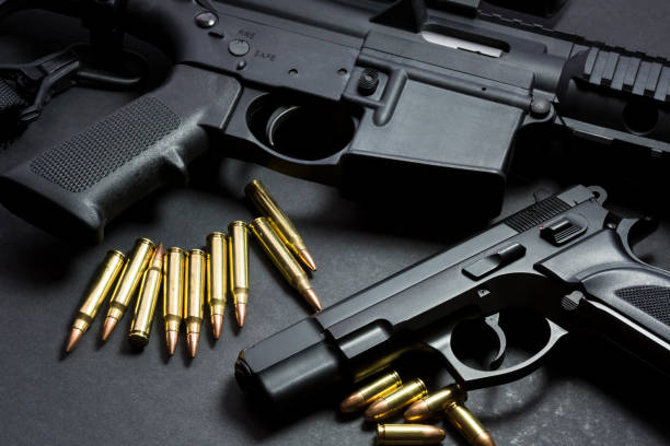 Guns 9mm handgun with ar15 rifle and ammunition ar 15 stock pictures, royalty-free photos & images