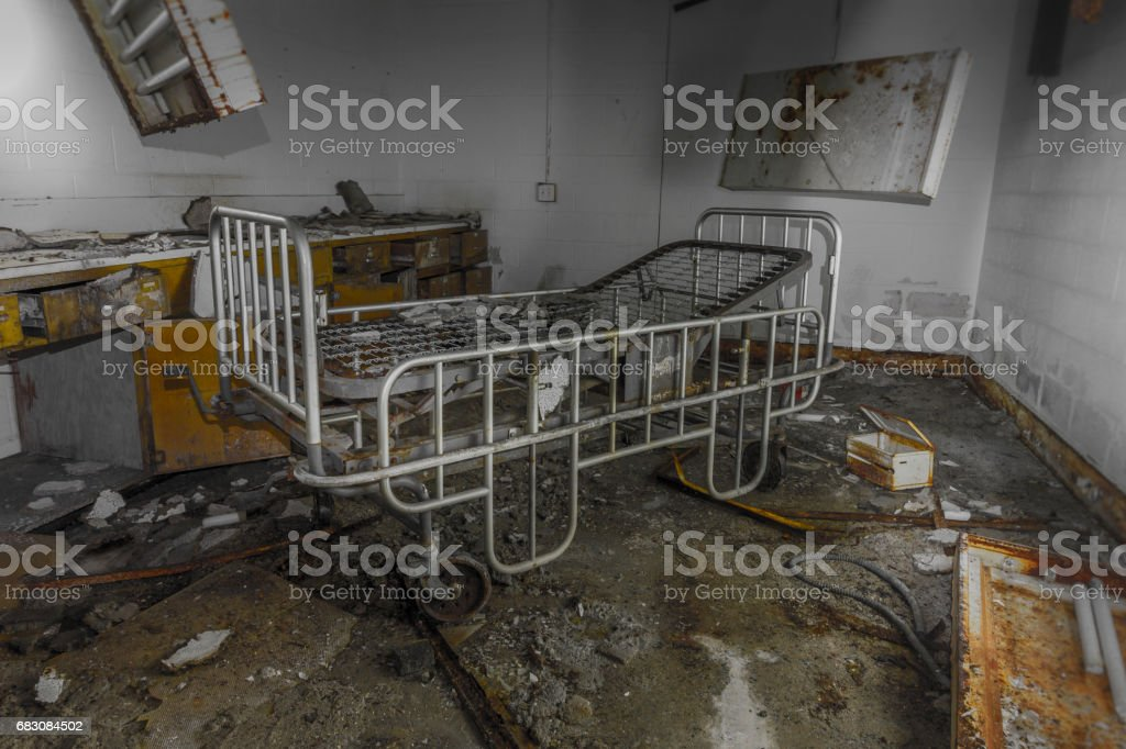 Gurney in an abandoned hospital stock photo