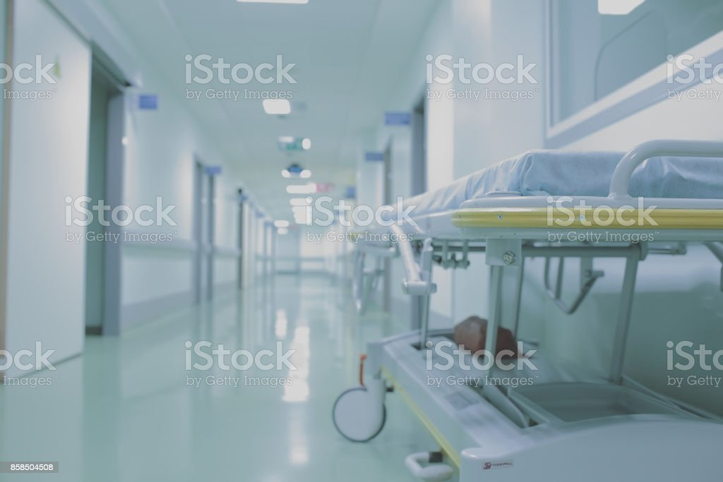 Gurney in empty hall of medical building stock photo