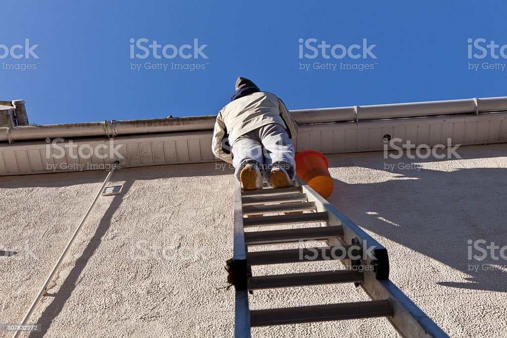 Gutter Cleaning and Roof Repairs stock photo