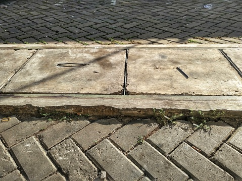 Paving stone and gutter cover in a parking lot