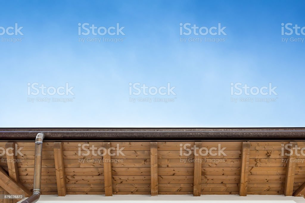 Gutter on the roof top of house stock photo
