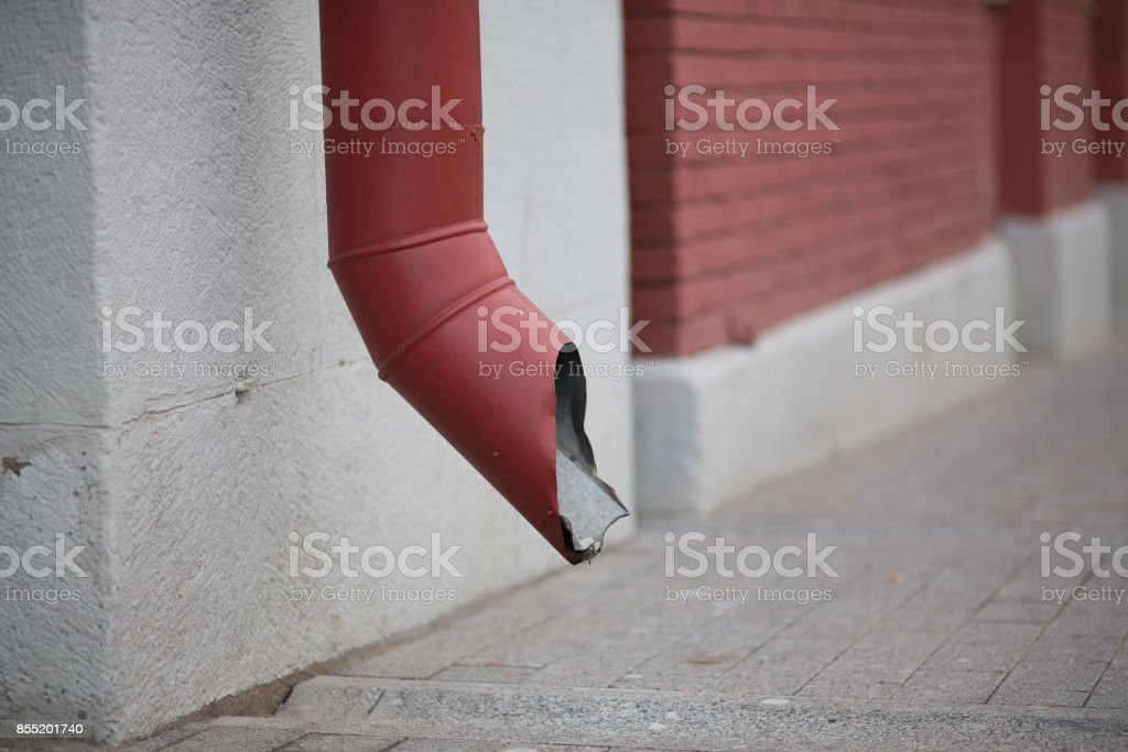 Gutter pipe on the wall of the building stock photo