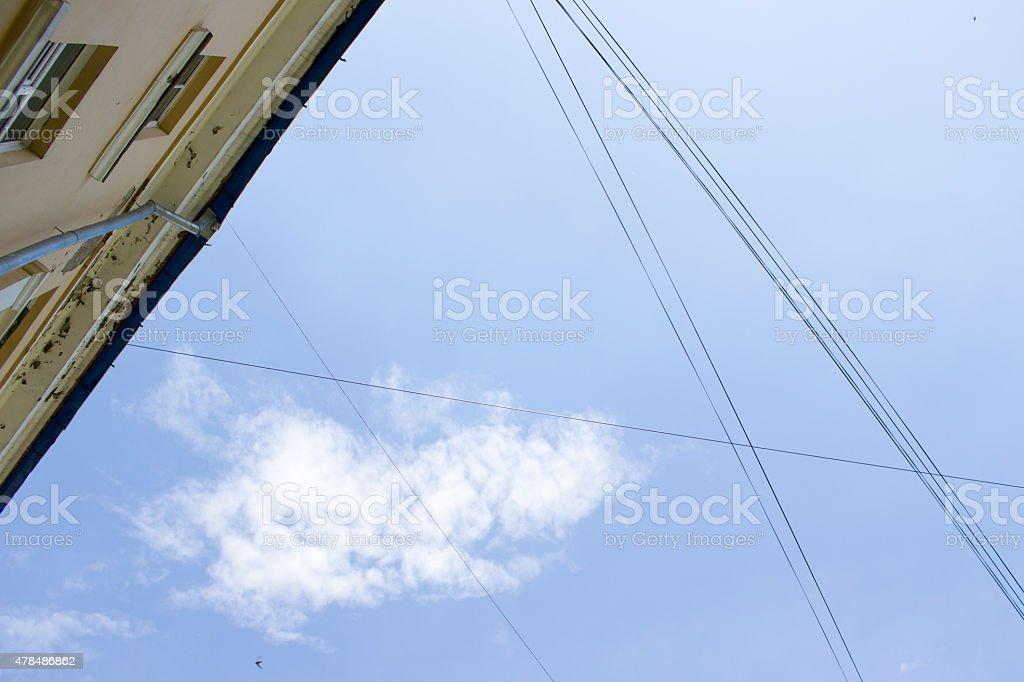 gutter under a cloudy blue sky stock photo