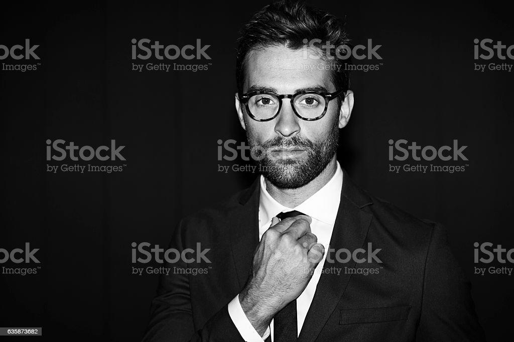 Guy adjusting tie stock photo