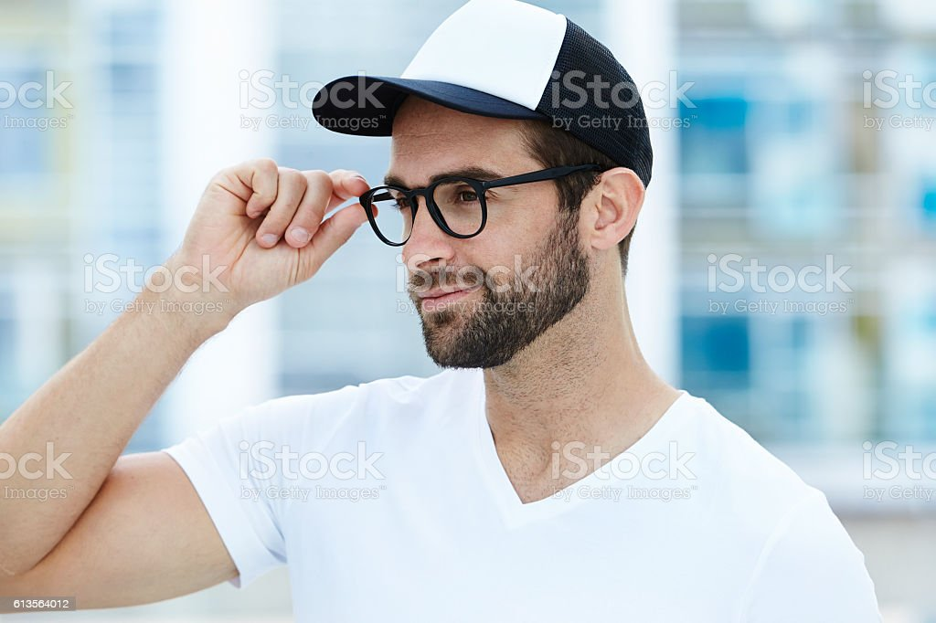 Guy adjusts specs stock photo