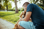 Guy and his dog, golden retriever, nature