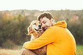 Guy and his dog, golden retriever, nature,labrador,three dogs