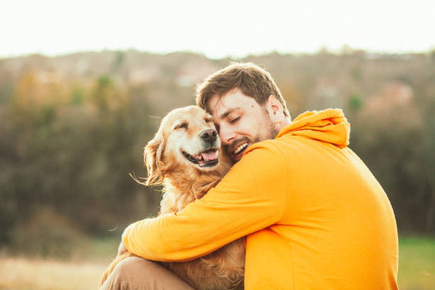 15,399 Man Hugging Dog Stock Photos, Pictures & Royalty-Free Images - iStock