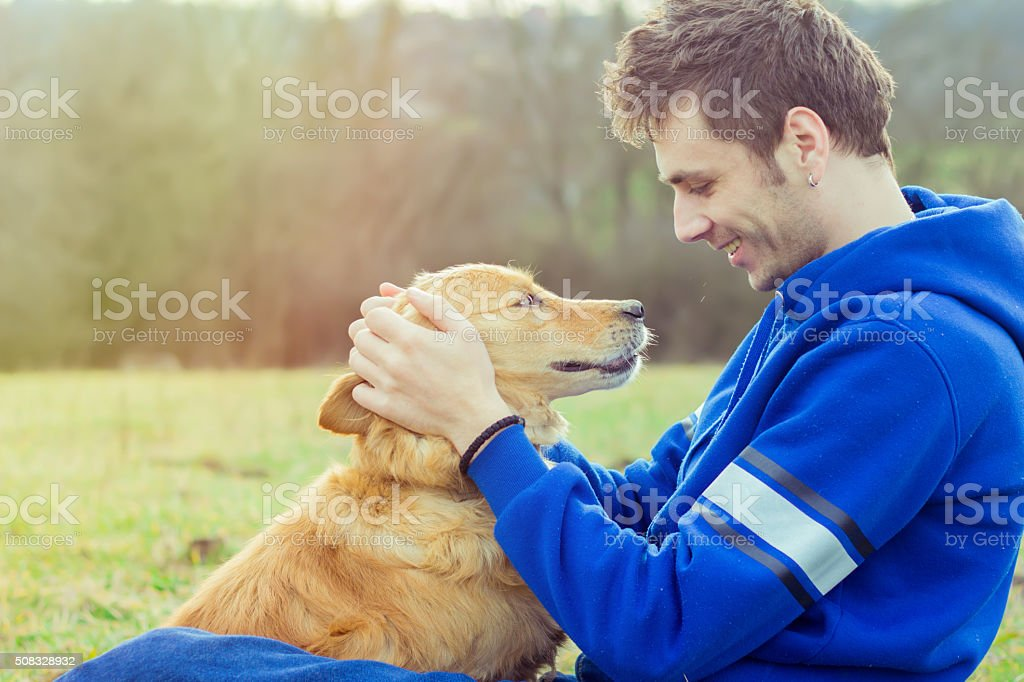 guy and his dog, golden retriever, nature stock photo