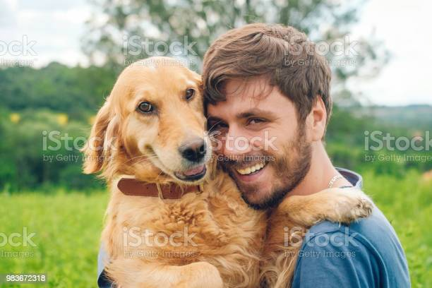 Guy and his dog golden retriever nature picture id983672318?b=1&k=6&m=983672318&s=612x612&h=pbvggdpiqigj42voi cnp6nprrw481cavtxclwlb40w=