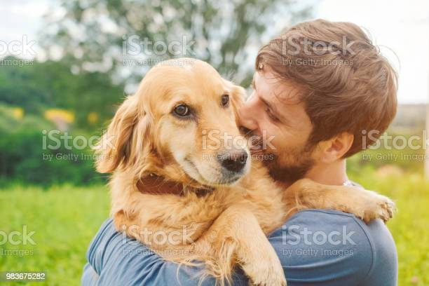 Guy and his dog golden retriever nature picture id983675282?b=1&k=6&m=983675282&s=612x612&h=jqfq1ac75kvpjpjkyu54bn6rkwyqtchc4sywxjhcdy8=