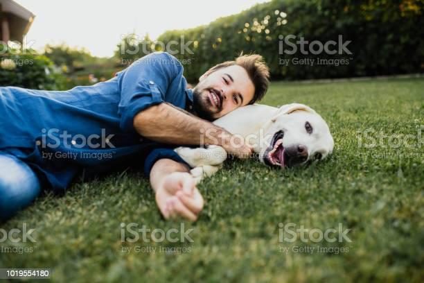 Guy and his dog labrador retriever courtyard picture id1019554180?b=1&k=6&m=1019554180&s=612x612&h=lt4mcsmityirgr1fdbgwhf5cv85o7k ojl2wbpjbesu=