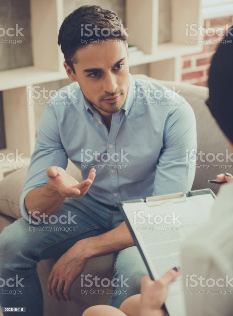 Guy at the psychologist stock photo