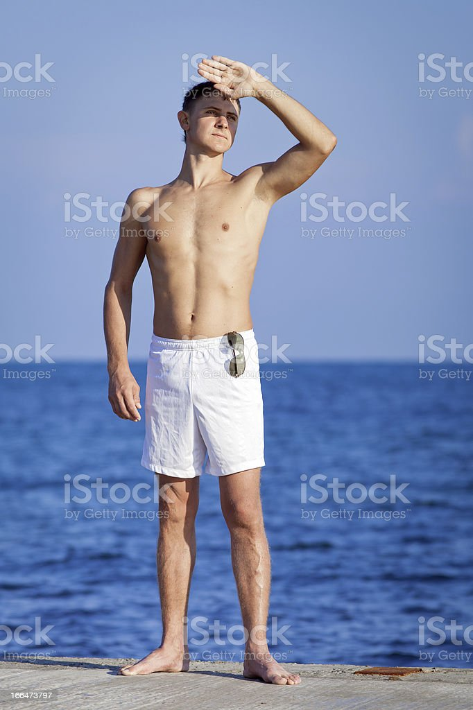 Guy at the sea stock photo