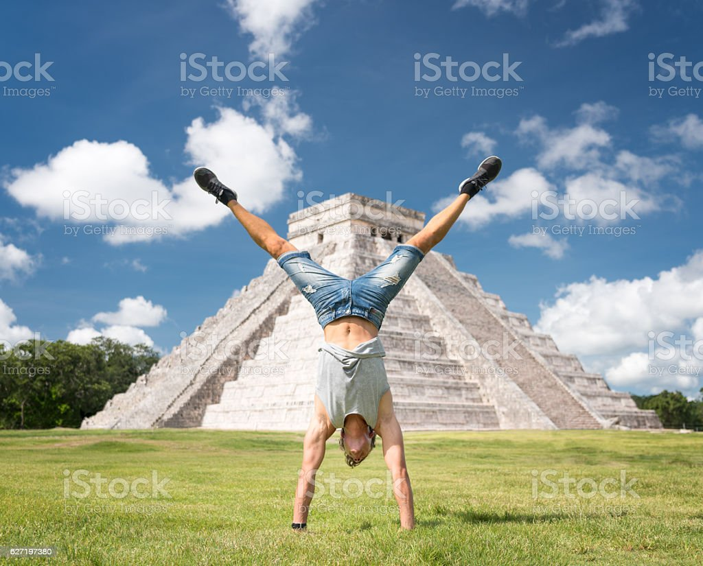 Guy doing a Handstand, Chichen Itza Mexico stock photo