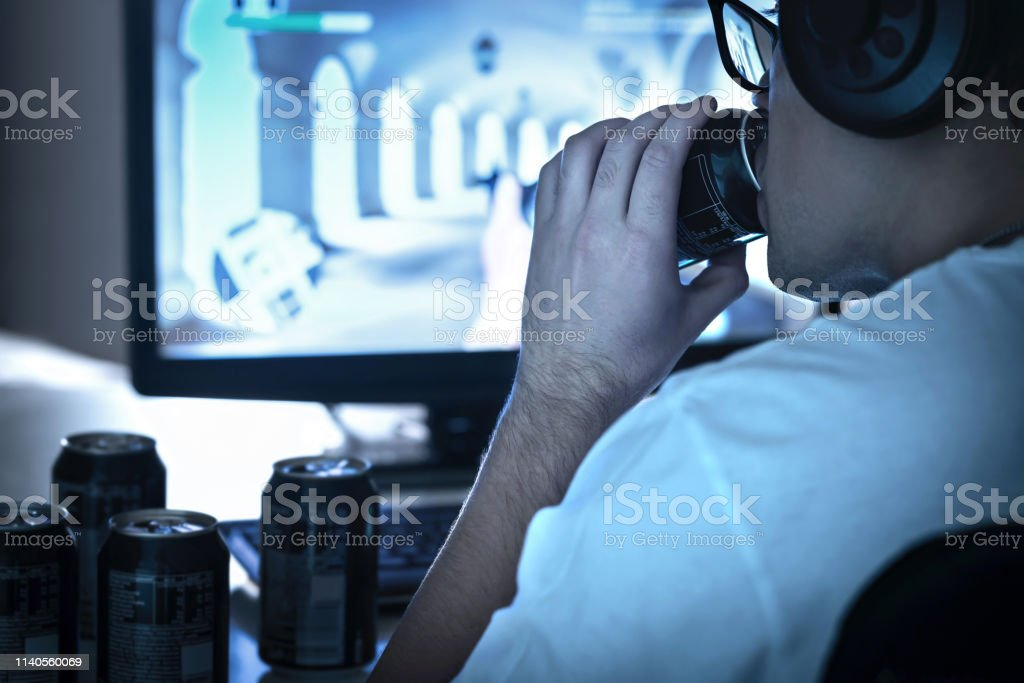 Guy Drinking Soda And Playing Video Game Or Watching Online