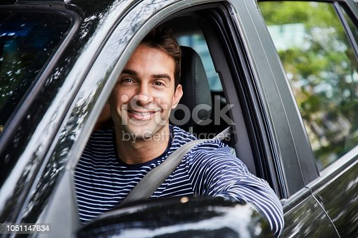 1051147634 istock photo Guy driving 1051147634