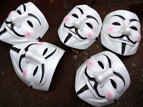 guy fawkes masks - anonymous group members - guy fawkes mask stock photos and pictures