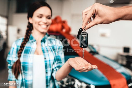 istock A Guy Gives A Car Key To Girlfriend. Gift Concept. 1032582210