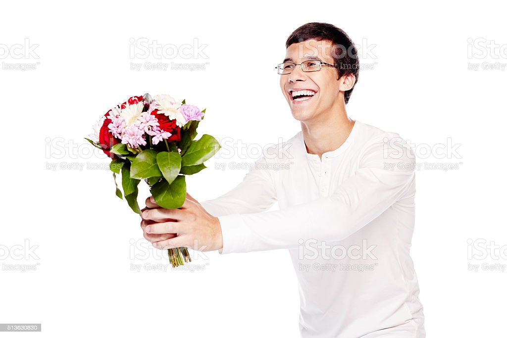 Guy giving bouquet of flowers stock photo