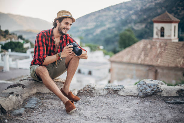 guy holding digital camera - men shoes stock pictures, royalty-free photos & images