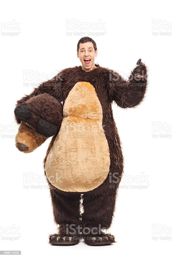 Guy in bear costume giving a thumb up stock photo