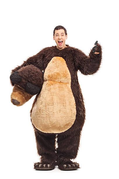 homme en costume d'ours pour un pouce levé - mascotte photos et images de collection