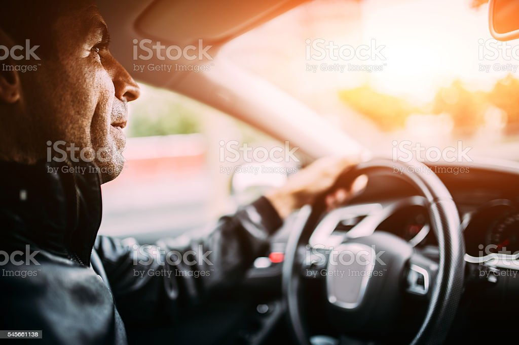 Guy in car stock photo