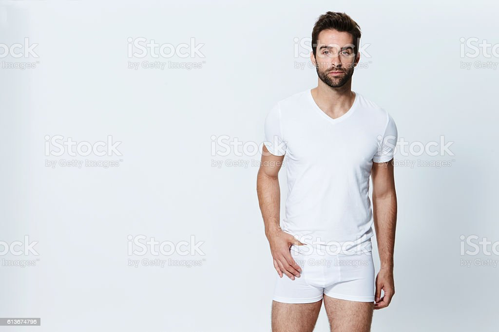 Guy in white briefs stock photo