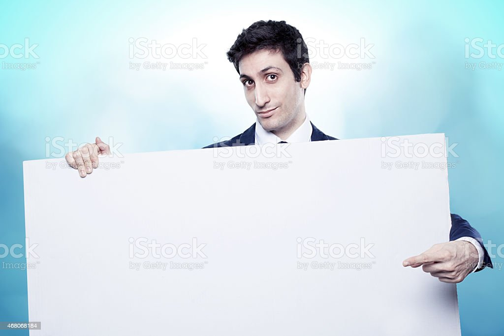 guy indicating a white board stock photo