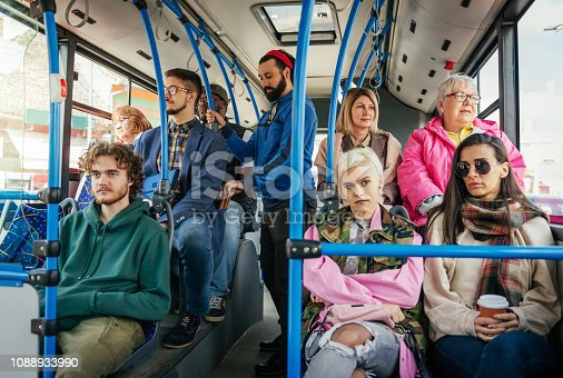 istock Guy is pickpocketing in the crowded bus 1088933990